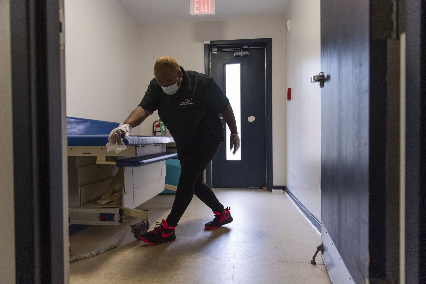 Man Cleaning the area before the Clorox Disinfecting Wipes opened